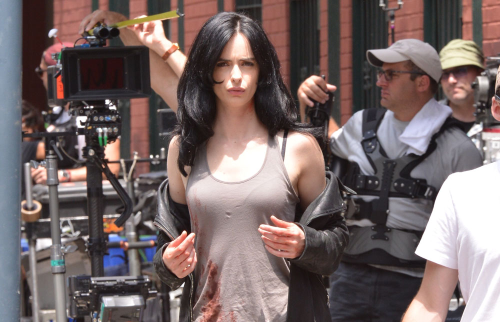 New Jessica Jones set photos reveal a bloodied Krysten Ritter. Catch the second Marvel Netflix series, coming to the streaming service later this year!
